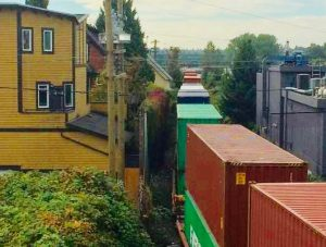 Train passes houses